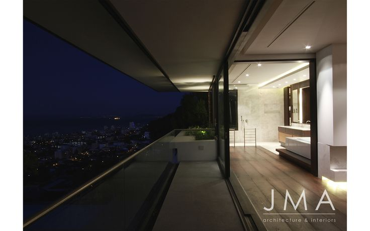 Night time, city view from this contemporary villa.