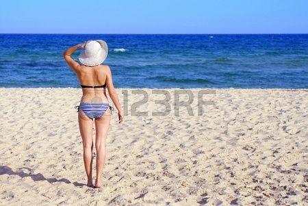Sexy woman with white hat -  accattivante, giovani, years, donne, donna, panorama, vacation, tropical, abbronzatura, costume da bagno, sole, estate, in piedi, sorriso, cielo, seduto, mare, sabbia, rilassato, rilassarsi, pretty, persona, persone, outdoor, one, oceano, naturale, vacanza, cappello, felice, glamour, ragazza, divertimento, figura, femmina, eleganza, carino, costa, caucasica, blu, bikini, bellezza, bellissima, moda mare, spiaggia, retro, aspettami