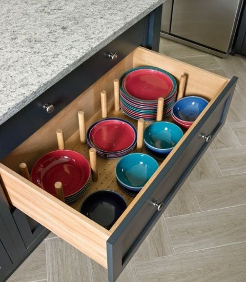 Kitchen island storage with built in plate organisers.