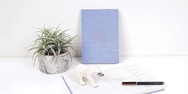 Introducing our first grid journal - create your own planner, jot down notes, or sketch your next project. This is where your creativity begins!  This hardcover fabric journal features a sophisticated front cover design with rose gold foil stamp. Includes 70 grid lined pages and a pocket on the back.