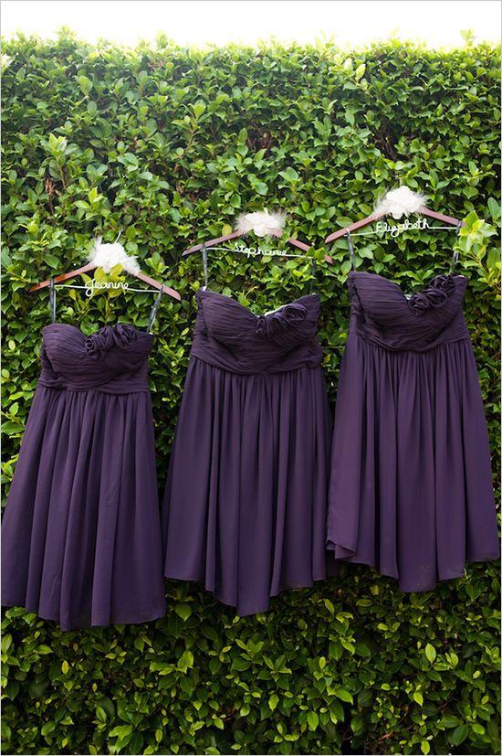 purple bridesmaid dresses on personalized wedding hangers