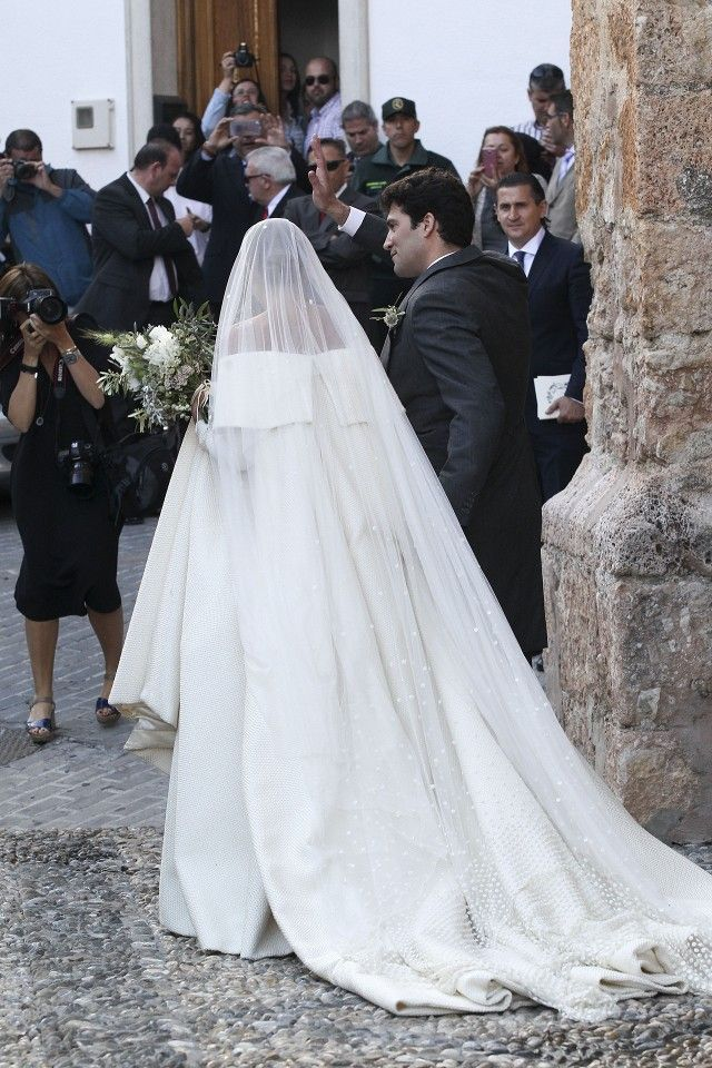 Lady Charlotte Wellesley wed in an on trend, off-the-shoulder, textured gown and a polka-dot veil