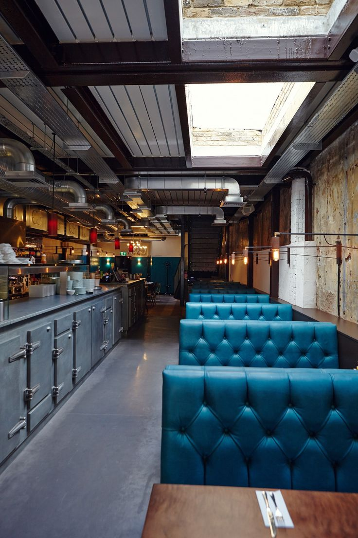 Great details, aqua leather split skylight, lighting. Interesting cool bar