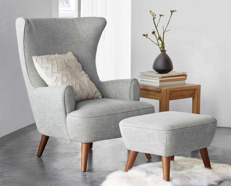 Dania - With an overall classic profile, the lines of the Katja high back chair add visual interest to your space. Carve out a special corner for this comfortable and roomy design. The tailored wingback style rests atop solid beech tapered legs with a walnut veneer for a mid-century modern touch.