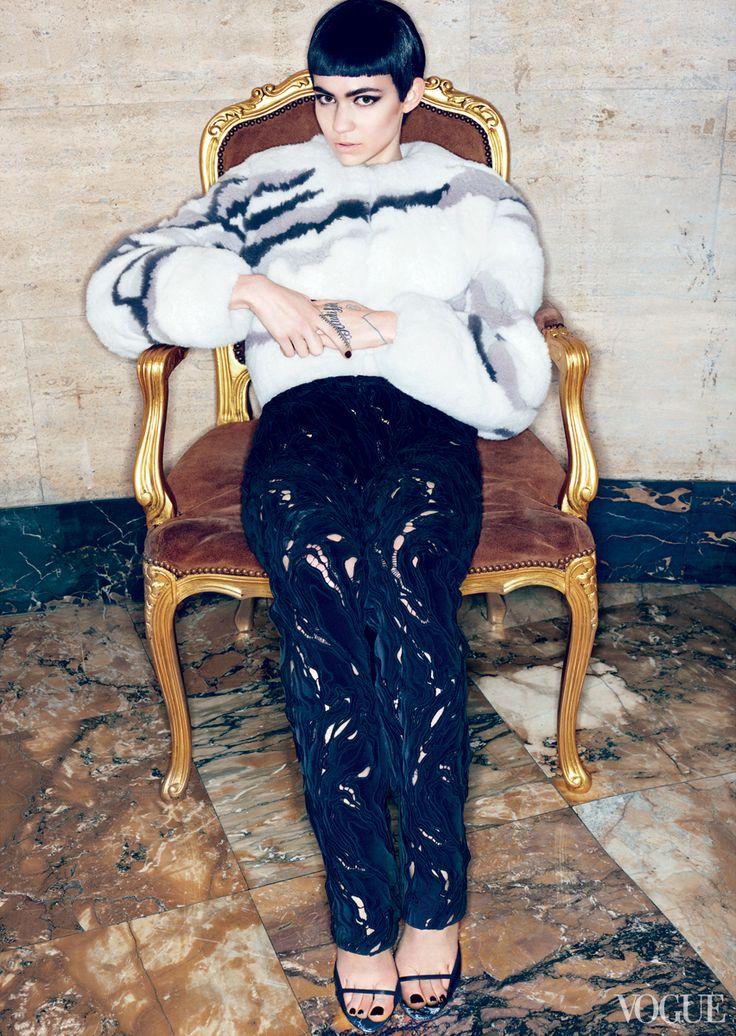 Canadian singer Claire Boucher, better known as Grimes, in a Balenciaga Scandinavian fox jacket, silk-velvet pants, and calfskin sandals.