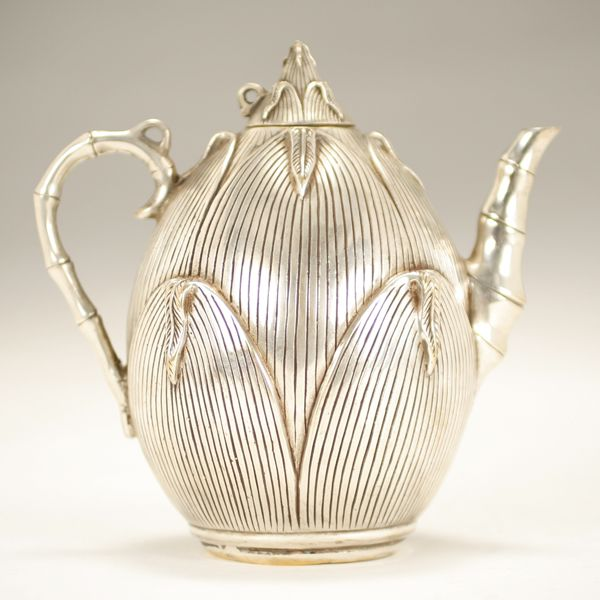 "Oriental / Japanese? teapot; silvered bronze vegetable form teapot with bamboo handle and spout. Four character mark impressed in square on base. 6"" H."