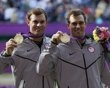 Brothers Bob Bryan (R) and Mike Bryan of the U.S. pose with their gold medals during the presentation ceremony after they defeated France's Jo-Wilfried Tsonga and Michael Llodra in the men's doubles tennis final match at the All England Lawn Tennis Club during the London 2012 Olympic Games August 4, 2012.
