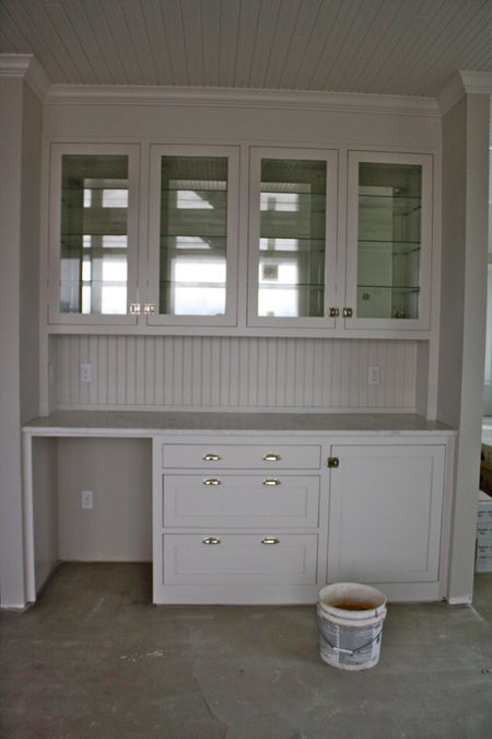 dining room - built in buffet with cupboards above for glassware storage