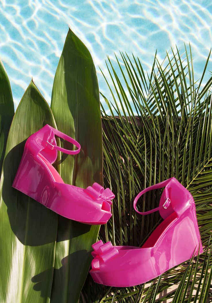 Let these jelly wedges bring a stunning smile to your face! Featuring flirty peep toes with decorative bows and sassy ankle straps, these sleek magenta platforms will leave you giggly and glossy for your a night on the town.