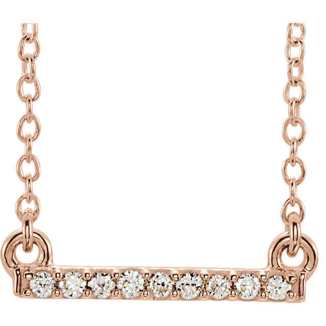 Petite Diamond Bar Necklace: 0.07 carats total weight, SI2 in clarity and H in color. Small and petite, great for layering necklaces together. Available in rose, white, and yellow gold in 14kt.