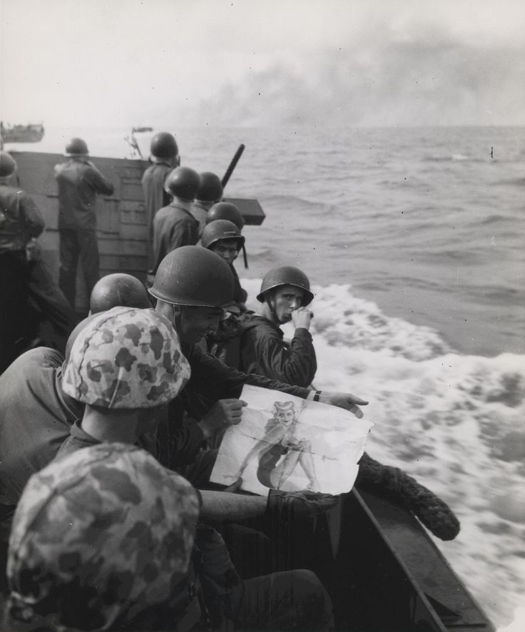 'Where Marines go their pin-ups go' - marines approaching Japanese-held Tarawa view a picture of a pinup girl November 1943 [1700 x 2048]