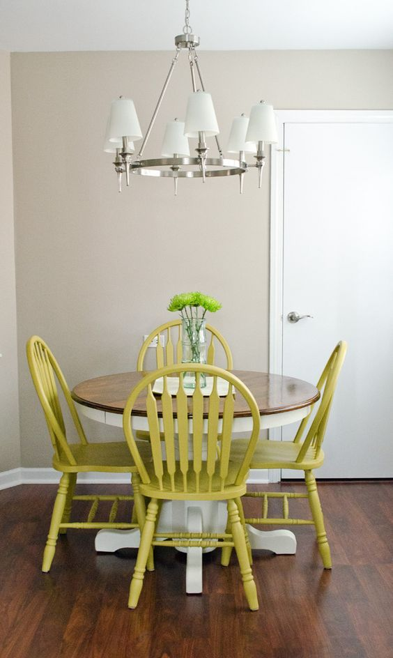 Lime Painted Wooden Kitchen Chairs With Round Table With White Legs And Dark Wood Top In A Room With Laminate Floor Kitchen Remodel: How to Spray Paint Wooden Kitchen Table and Chairs, How to paint a wooden kitchen table and chairs, Painting wooden kitchen table and chairs