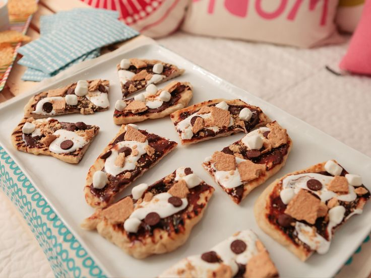 S'mores Pizzette recipe from Giada De Laurentiis   Food Network. Note: S'mores ingredients are spread/sprinkled atop a grilled pizza crust.