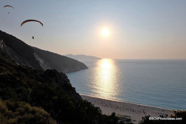 A couple of Paragliders suddenly become the subject of interest looking from above the steep cliffs of Myrtos contrasting against the mild colors of the sunset.    #sunset   #landscape   #seascape   #paraglider   #myrtosbeach   #myrtos   #kefalonia   #Cephalonia   #fujifilm   #fujixm1   #Greece