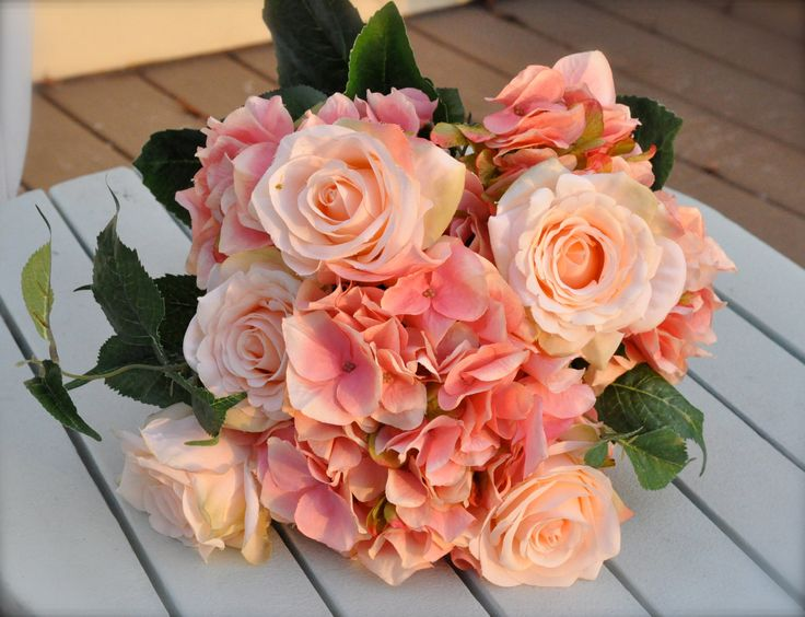 Coral, salmon rose wedding bouquet.. $65.00, via Etsy. Love the fun little simple flowers. Forgot name.... Could find turquoise colored ones! I think they're called pacific somethings.