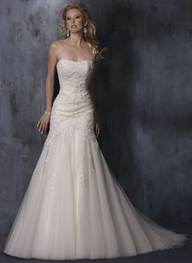 i tried on this dress...and one very similar to this, but a lot of lace. i love dress shopping!!!