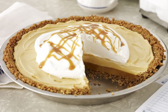A butterscotch pudding pie with a pecan-graham crumb crust and a caramel drizzle - have we got your attention yet?  This Butterscotch-Pecan Pudding Pie is a must-try recipe!