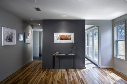 Interesting - a darker gray as an accent to gray?  Notice that they painted the base boards the same color as the walls.