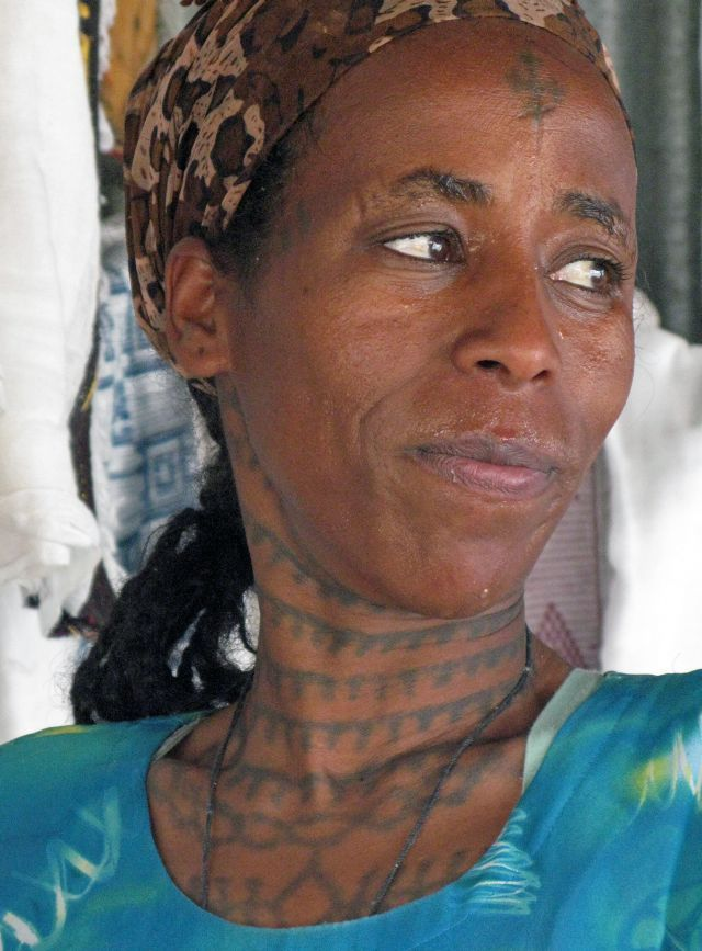 Africa | Tigray woman • Axum, Ethiopia. Not an uncommon sight in the Amhara and Tigray regions of northern Ethiopia are religious tattoos known as n'qsat (ንቅሳት). | ©Siegfried Ehrmann