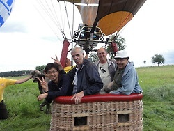 Behind the Scene #VHessconf 100 Years Cosmic Rays Anniversary of Their Discovery by Victor Hess -  In the basket of the yellow balloon stands second and last from left to right the two grandsons of Victor Hess.  (credit: HAP / A.Chantelauze)