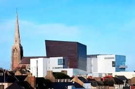 """""""Wexford Opera House"""" it is bold, at night it has lights that constantly change…"""