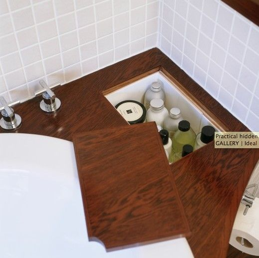 (Use sunk in compartment in earth floor covered with wooden covering) hidden storage love for tub, shampoo, conditioner, etc. Attach handle and hinges for easy opening