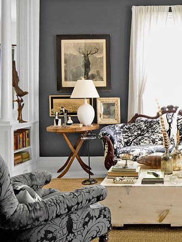 A palette of grays and browns creates a neutral, yet still dramatic, backdrop for the cabinet-of-curiosities vibe in Sarah Gray Miller's living room.