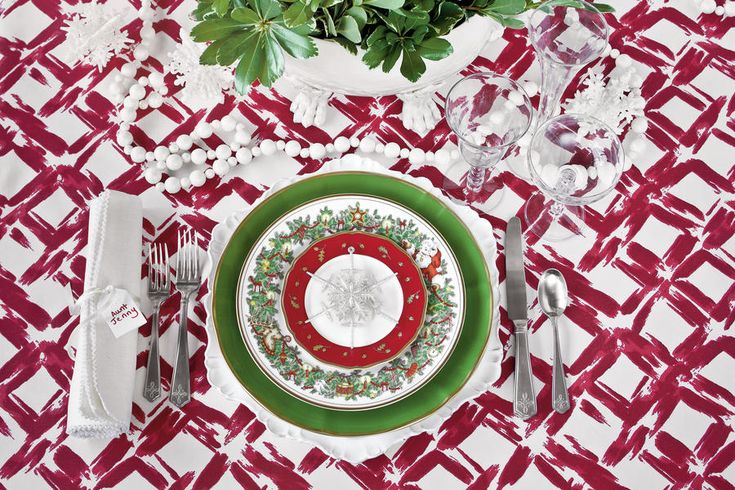 St. Nicholas by Fitz and Floyd - 5 New Ways with Classic Christmas China - Southernliving. circa 1980The Pattern: A bevy of holiday icons, including Santa himself, makes this a long-standing favorite.  The Setting: For tradition with a twist, layer this look with lots of red, white, and green. Scatter beaded garland and snowflake ornaments along the table, and fill a pretty urn or soup tureen with simple greenery for a quick centerpiece.  Get The Look