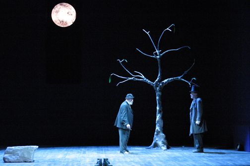 Vladimir and Estragon standing in front of the tree, where they stay throughout the whole play.
