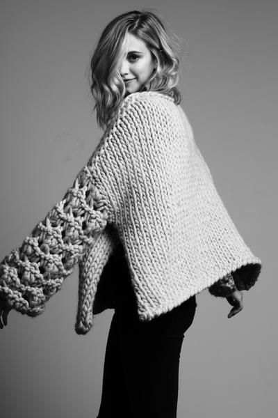 """""""The Kristen"""" is a luxurious, oversized sweater with floral lacework sleeves. This sweater was designed to be effortless and cozy with an open sides and a draped rectangular shape to create movement."""