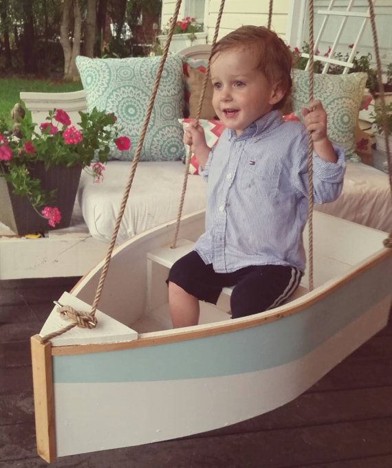 This wood boat swing is 16 in wide by 30 in long. It can swing from a porch, a tree, or a swingset. It is constructed of outdoor materials and