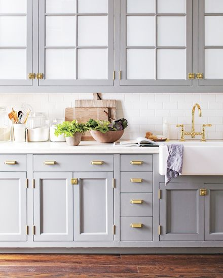 Big fan of the blue/gray kitchen cabinets, with brass hardware, and apron front sink.
