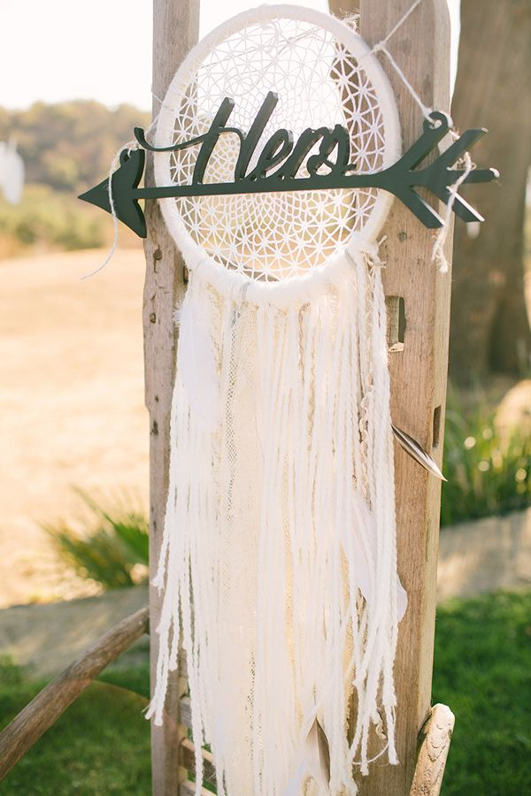 dream catcher chair decor - photo by Vis Photography http://ruffledblog.com/handcrafted-boho-woodsy-wedding #chairdecor #weddingideas #bohemianwedding