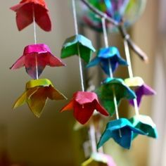 A Flower mobile made from recycled egg carton. Painted with watercolors. Fun Earth Day project.