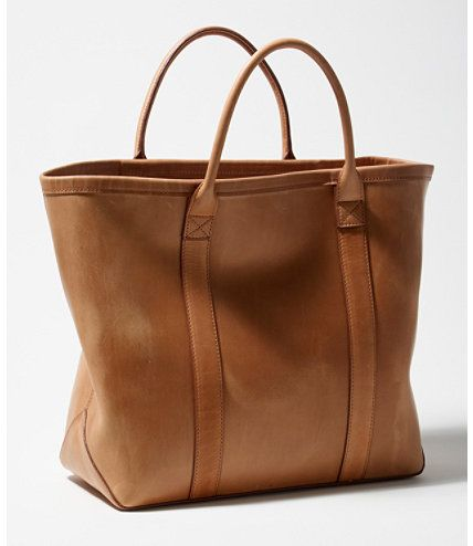 """An amply sized tote in a classic silhouette inspired by the original L.L.Bean Boat and Tote®. Rolled carry handles. Interior drop pocket with zipper closure. Expertly crafted from 100% vegetable-tanned leather, our tote possesses a unique natural character that gains more and more personality the more you use it. Measures 14""""H x 15""""W x 7""""D. Imported. </p>"""