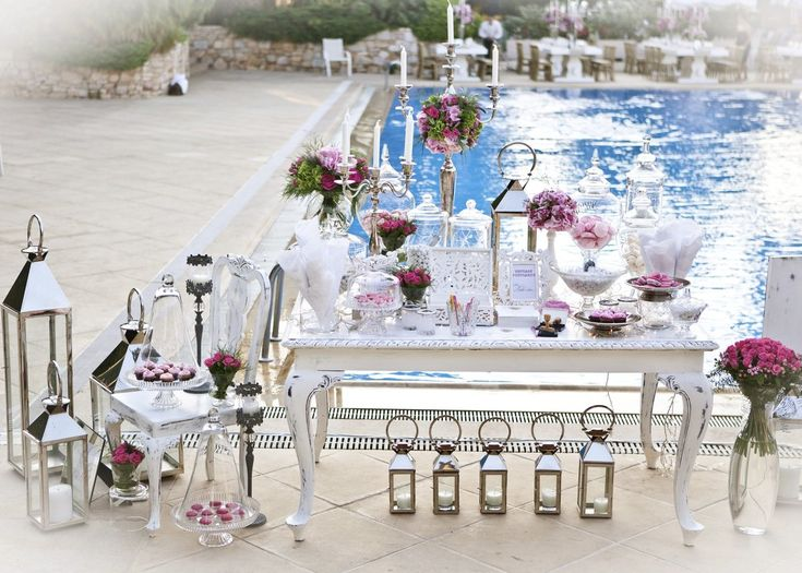 De Plan V » La Vie En Rose Wedding @ Ekali Club, welcome dessert table, silver plate candle holders, lanterns, flower compositions, luxury, outdoor, pool