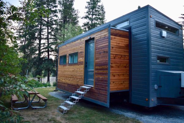 Couple S Expanding Tiny House On Wheels Almost Doubles In Space With Slide Outs Aurora Model Built B Off Grid Tiny House Best Tiny House Building A Tiny House