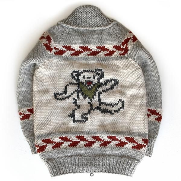Official Grateful Dead Marching Bear Sweater  The Bear logo was created by Bob Thomas, and was first seen on the 1973 Bear's Choice album cover. Bear was Owsley Stanley, the Dead's longtime sound engineer and, in the early days, benefactor. He was always known as Bear. When the album came out in 1973, it was decided to make these bears the logo for the album. Bear always said they were marching bears, not dancing bears.