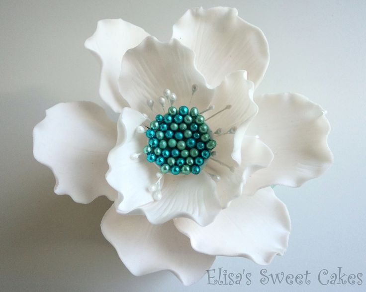 Gum paste flower 6 big petal and 5 small petal. I used a large rose/ teardrop cutter cut out the gum paste and then place the petal in betwe...