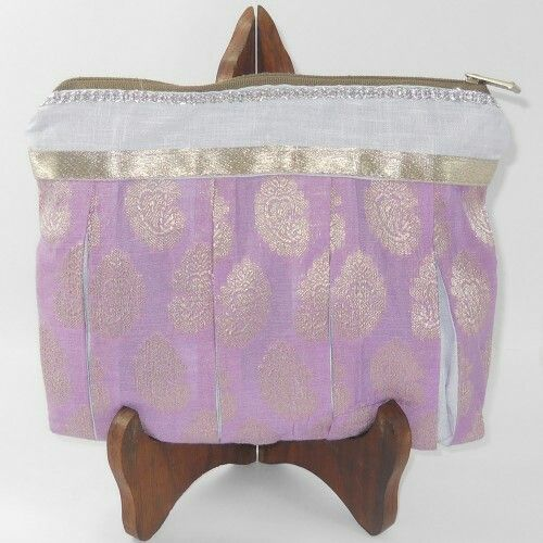 Utility Pouches - (Thistel Silver strip)  Shopibiz presents handmade utility pouch it is made from light thistle coloured cotton fabrics with golden thread floral print. Silver lace at top side of pouch. This multipurpose zip pouch measures 7.5 inches tall X 10.5 inches wide. Put your toiletries, make-up, lingerie, wires and cables, gadgets etc. Fit in the world into these pouches while on a trip or just for storage. The wide mouth helps for easy access to your belongings.
