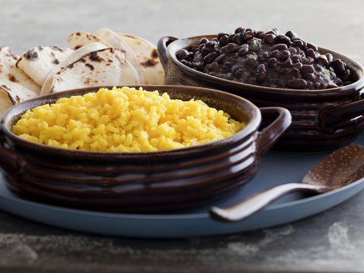 Spicy Black Beans and Yellow Rice recipe from Tyler Florence via Food Network