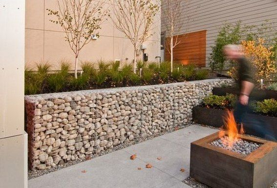 Concept for low gabion planters + wood planter/pedestals with pebble tile floor inset (lit from recessed pedestal base)