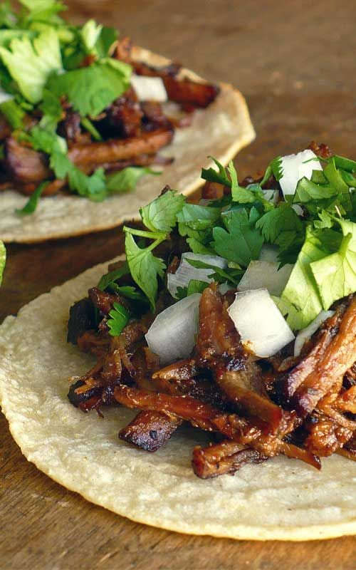 Recipe for Tacos De Barbacoa - Good barbacoa is succulent beef that is slow-simmered in a spicy broth flavored with tangy lime juice, smoky chipotle chiles and plenty of garlic until it's practically falling apart.[amd-zlrecipe-recipe:1313]Recipe and Photo: Food.People.Want