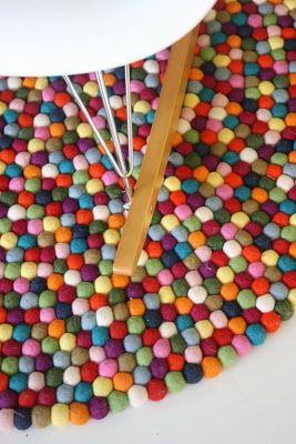 Pinocchio, design by Hay Design TeamNamed after a Danish candy – colorful, sugarcoated licorice balls – Pinocchio is a carpet that makes you smile. Handmade in Nepal. Every single ball is felted by hand and afterwards put on a string like pearls.