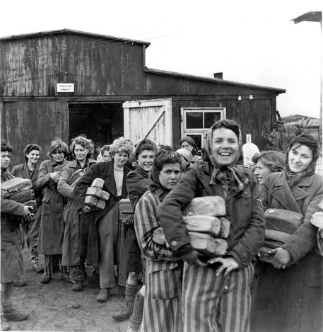 Bergen Belsen, Germany, A group photograph of women survivors holding bread loaves, after the liberation, April 1945.