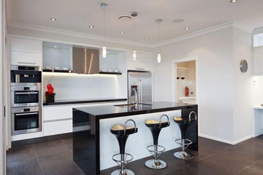 light cabinets, dark benchtop and dark floor