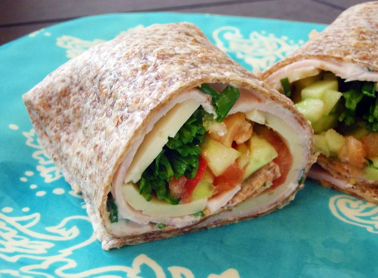 California Turkey Wrap:2 tablespoons nonfat Greek yogurt 1 tablespoon chives, chopped Lime juice, to taste ½ avocado, diced ½ tomato, chopped ½ cucumber, peeled, seeded, and diced 1 sprouted grain tortilla Turkey breast slices 1 slice pepper jack cheese ¼ cup alfalfa sprouts