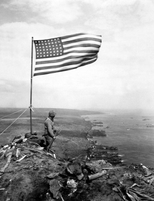 I love this picture!! A Marine standing on top of Mt. Suribachi, Feb 1945