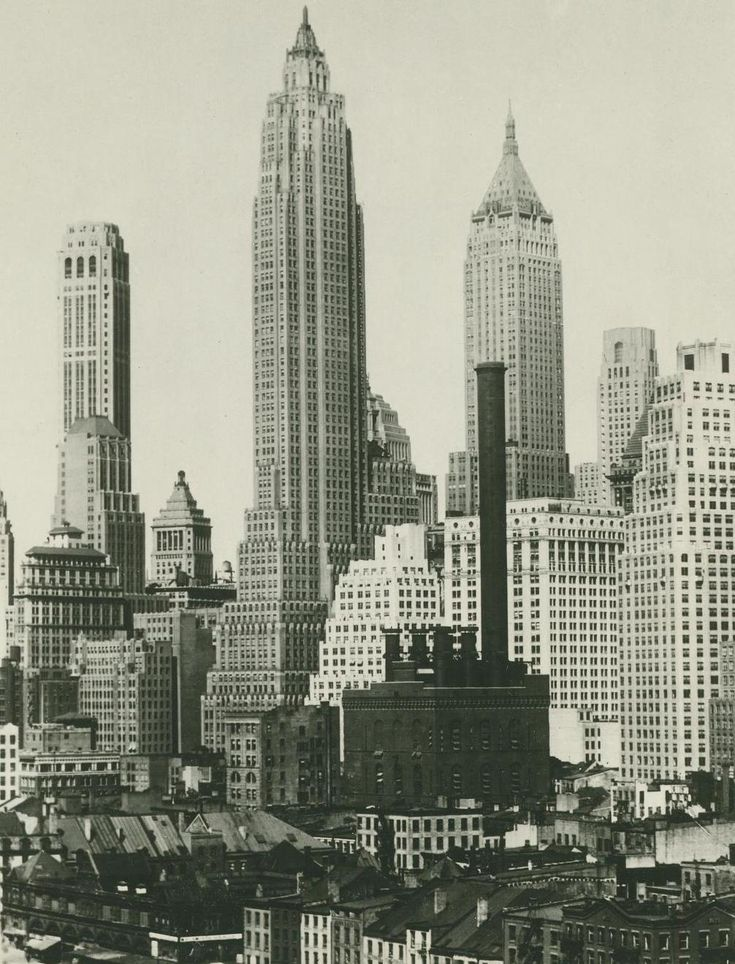 Downtown Manhattan in the 30s.  The tall skyscraper in the middle is the American International Building.
