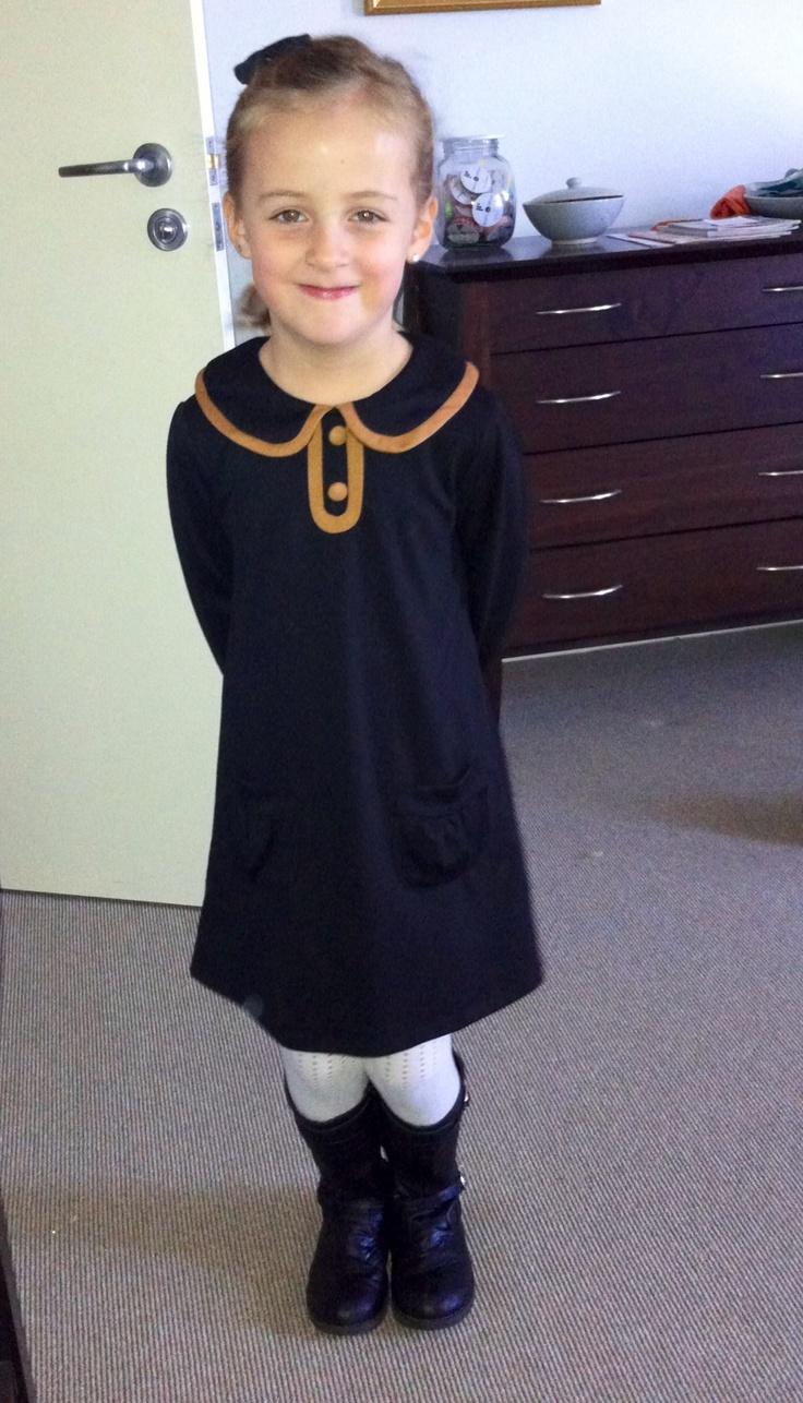 Black stylish dress. Very grown up.  Kids fashion.